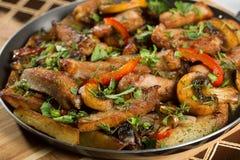 Roast meat in a frying pan. Stock Photo