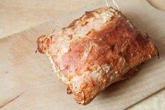 Roast meat lies on a board Stock Photos