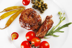 Roast meat medallion with cherry Stock Image