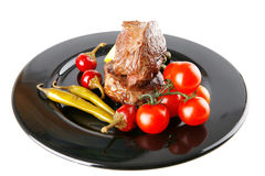 Roast meat medallion with cherry Stock Images