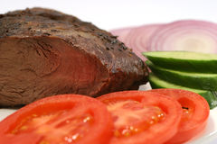 Roast meat piece and vegetables. On dish Royalty Free Stock Photography