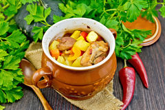 Roast meat and potatoes in portion pot on board Stock Photo