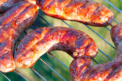 Roast meat sausage on the barbecue Stock Photography