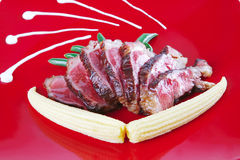 Roast meat served with corns Royalty Free Stock Photo