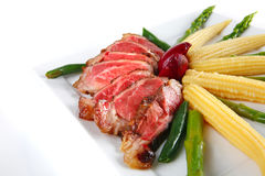 Roast meat served with corns Stock Photography