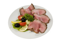 Roast meat slices. On white plate Stock Images