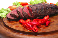 Roast meat,slices and vegetables Royalty Free Stock Photo