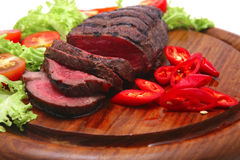 Roast meat,slices and vegetables royalty free stock image