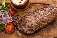 Roast meat steak with vegetable garnish and sauce Stock Photos