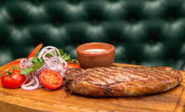 Roast meat steak with vegetable garnish and sauce Royalty Free Stock Images