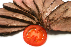 Roast meat and tomato. On dish Royalty Free Stock Image