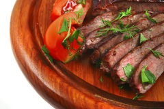 Roast meat and vegetables Stock Images