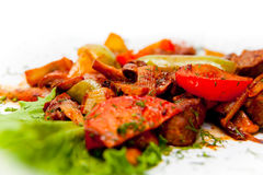 Roast meat with vegetables decorated with lettuce leaf Stock Photography