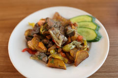 Roast meat with vegetables Stock Photos