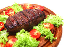 Roast meat on wooden plate Royalty Free Stock Photos