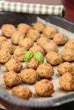 Roast meatballs on baking sheet Stock Photos