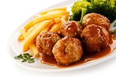 Roast meatballs with french fries and vegetables Stock Photography
