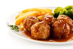Roast meatballs with french fries and vegetables Royalty Free Stock Photo