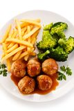 Roast meatballs with french fries and vegetables Royalty Free Stock Image