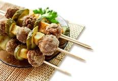 Roast meatballs on skewers Royalty Free Stock Photography