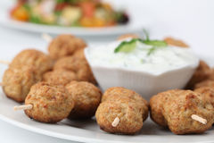 Roast meatballs on skewers and tzatziki Stock Images