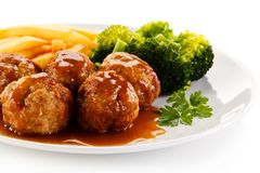 Roast meatballs and vegetables Royalty Free Stock Image