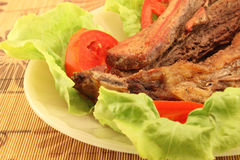 Roast meats with lettuce and tomatoes Stock Photos