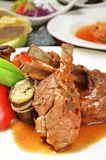 Roast mutton chops. On dinner table delicacy roast mutton chops stock images