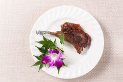 Roast mutton chops. In a white dish stock image