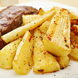 Roast Parsnips and Grilled Steak Royalty Free Stock Image