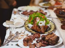 Roast pig with vegetables on a banquet table, Ukrainian dish Stock Photography