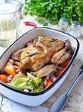 Roast pigeon with Cassoulet beans, onions, bacon, carrots, broccoli, rosemary and parsley Stock Photo