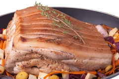 Roast pork. With vegetables in a pan Stock Images