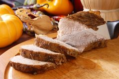 Roast pork. On a wooden board Royalty Free Stock Images