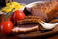 Roast pork. Close-up of a roast tenderloin pork served with vegetables Stock Images