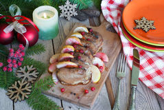 Roast pork with apples and cranberries Stock Photography