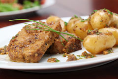 Roast pork with baby potatoes Royalty Free Stock Photography