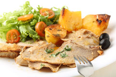 Roast pork beef dish with salad and potatoes Stock Photos