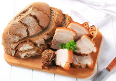 Roast pork belly. With bread and garlic Stock Image