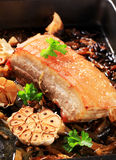 Roast pork belly. With garlic and onion Royalty Free Stock Photography