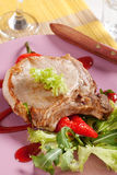 Roast pork chop and accompaniment Stock Image