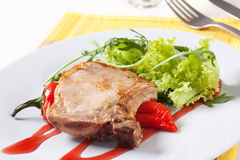 Roast pork chop and accompaniment Royalty Free Stock Photo