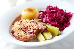 Roast pork chop with potato dumplings and red cabbage Royalty Free Stock Image