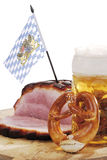 Roast Pork with Crackling, pretzel and a mug of beer on wooden board Stock Photos
