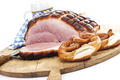 Roast Pork with Crackling, pretzel and a mug of beer on wooden board Royalty Free Stock Photo