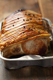 Roast pork. Pork roast with crispy skin royalty free stock images