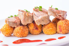 Roast pork with currant sauce. Detail of Home meda Delicious roast pork with currant sauce and home made croquette Stock Photo