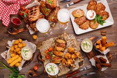 Roast pork and different sausages served with vegetable garnish Royalty Free Stock Photos