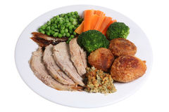 Roast Pork Dinner. Traditional Sunday roast pork dinner with the trimmings Royalty Free Stock Photography