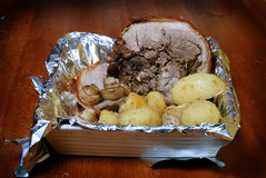 Roast pork dinner. Roast pork, potatoes,and mushrooms straight from the oven royalty free stock photo